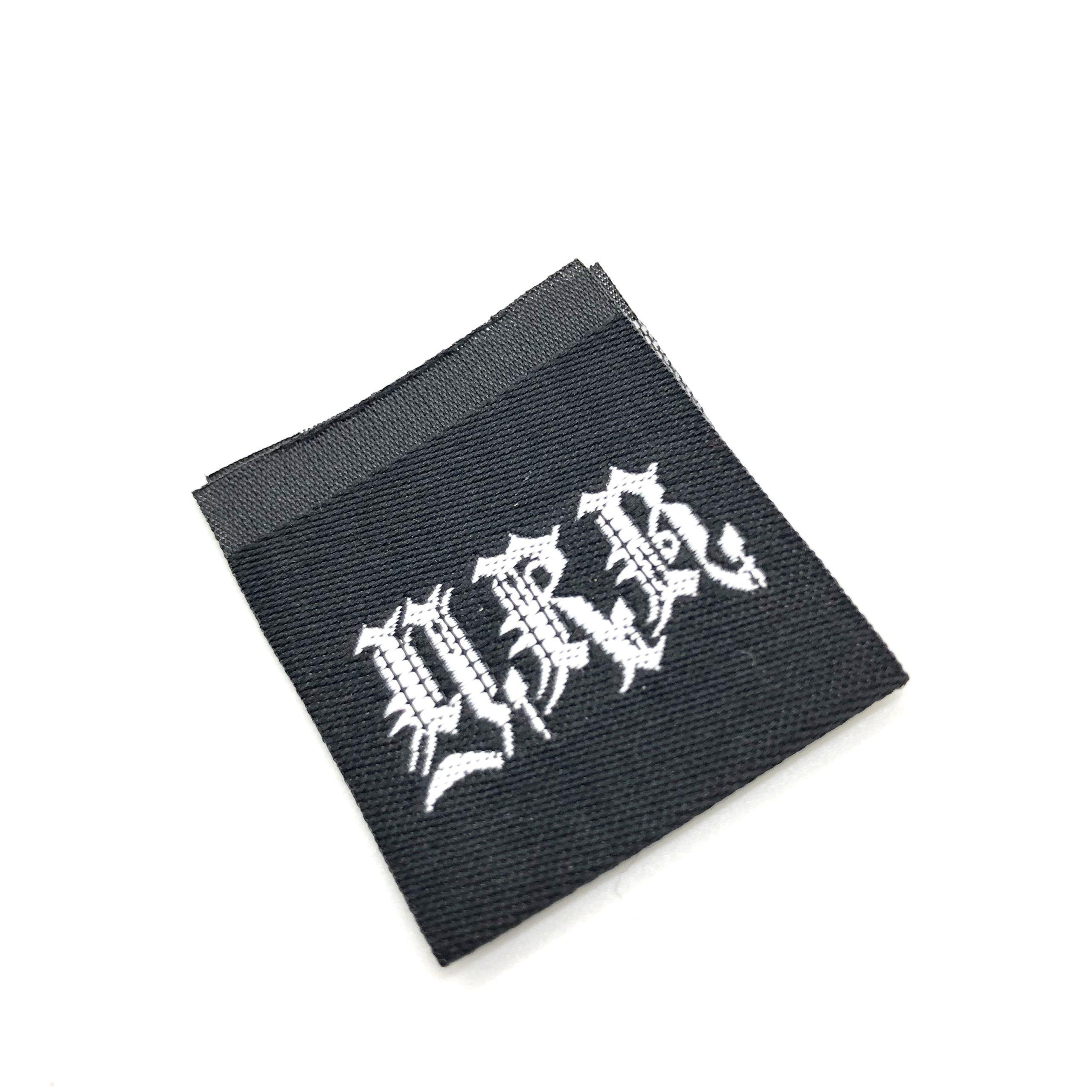 本格的なオリジナル刺繍タグ(織ネーム)制作例